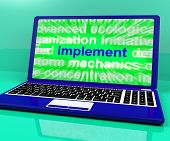 foto of execution  - Implement Laptop Showing Implementing Or Executing A Plan - JPG