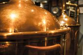 image of pressure vessel  - Large copper container for brewing many reflections of light.