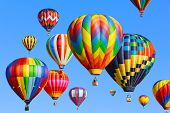 picture of air transport  - Colorful hot air balloons over blue sky - JPG