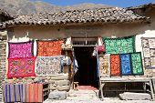 picture of andes  - Traditional woven fabrics for sale at a tourist spot in the high Andes Ollantaytambo Urubamba Valley in Peru on the road from Cuzco to Machu Picchu Sacred Valley