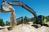 picture of sand gravel  - excavator machine at excavation work in sand quarry - JPG