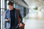image of smiling  - Man on smart phone  - JPG