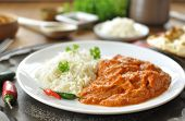 stock photo of curry chicken  - Chicken curry on a plate with rice an chilli pepper