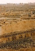 picture of zenobia  - the ruins of the roman city of palmyra stretch into the horizon in the syarian desert