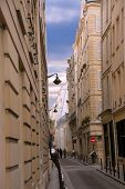 Narrow street of Paris France with blue sky