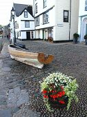 foto of dartmouth  - Cobbled pathway houses with a boat and flowers photographed at Dartmouth in Devon - JPG