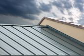 stock photo of roofs  - New corrugated metallic gray roof of new house - JPG