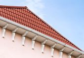 stock photo of gable-roof  - Roof with red tiles on background of blue sky - JPG