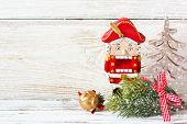 stock photo of nutcracker  - Christmas decorations with nutcracker and Christmas tree on a white background with copy space - JPG