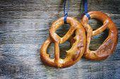 picture of pretzels  - pretzels on a dark wood background - JPG