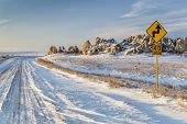 picture of prairie  - back country road over prairie at Natural Fort in northern Colorado in winter scenery - JPG