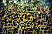 pic of lobster trap  - background of piled group of fishing cage traps  - JPG