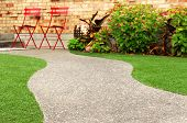 foto of clippers  - Walk way with perfect grass landscaping with artificial grass in residential area - JPG