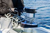 image of work crew  - Crew work with genoa sheet rope and winch on sailing boat - JPG