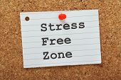 image of breather  - The phrase Stress Free Zone typed on a piece of lined paper and pinned to a cork notice board as a reminder - JPG
