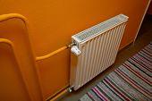 pic of thermos  - Heating radiator detail against orange wall - JPG