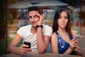 image of status  - Young adult couple has privacy problems with modern technology - JPG