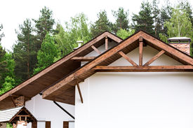 image of gable-roof  - Gable of new house with roof rafters and brick chimney - JPG