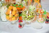 picture of fancy cake  - Served Banquet Table With Small Fancy Cakes and Fruits  - JPG