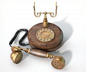 pic of embellish  - A vintage wood and brass telephone with dial embellishments and the handset lying off the hook on an isolated white studio background - JPG