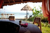 image of beach hut  - Flowers on bartender counter on the beach of Bali