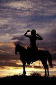 foto of redneck  - A silhouette of a woman in the outdoors sitting on her horse - JPG