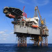 picture of rig  - Offshore Jack Up Drilling Rig Over The Production Platform in The Middle of The Sea - JPG