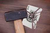foto of ace spades  - Hammer with a broken card vintage look ace of spades - JPG