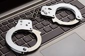 pic of handcuff  - Photo Of Handcuffs Lying On Laptop Keypad - JPG