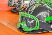 picture of firemen  - firemans safety hard hat on the table - JPG