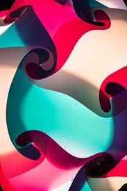 foto of lamp shade  - A close up shot of a lamp shade made up of interlocking colors - JPG