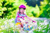foto of daisy flower  - Happy child riding a bike - JPG