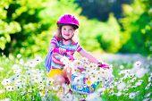 foto of cute kids  - Happy child riding a bike - JPG