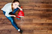 picture of broom  - Cleanup housework concept. cleaning woman sweeping wooden floor with red small whisk broom and dustpan unusual high angle view