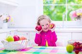 stock photo of healthy eating girl  - Child eating breakfast - JPG