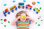 picture of railroad car  - Child playing with wooden train - JPG
