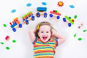 stock photo of railroad car  - Child playing with wooden train - JPG