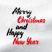 pic of merry christmas text  - Merry Christmas and Happy New Year calligraphy text on snowy background vector winter card - JPG