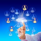 stock photo of peer  - Hand of a white collar worker stretching index finger to contact some female and male professionals via a cloud network - JPG