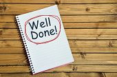 image of job well done  - Well done word closeup on notebook page - JPG