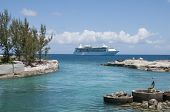 stock photo of off-shore  - Cruise Ship anchored off shore at a lagoon entrance with blue water and sky - JPG
