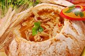 stock photo of tripe  - traditional polish tripe soup with tomato and vegetables in bread bowl