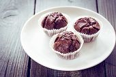 picture of chocolate muffin  - Chocolate muffins with chocolate on white plate - JPG