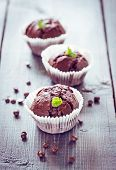 picture of chocolate muffin  - Chocolate muffins with chocolate on wooden background.
