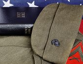stock photo of united states marine corps  - United States Military Flag and Bible Closeup - JPG