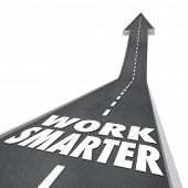 stock photo of efficiencies  - Work Smarter words on a road and arrow rising up to illustrate streamlining your process - JPG
