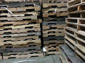 foto of wooden pallet  - Wooden pallet stacks in a Distribution factory - JPG