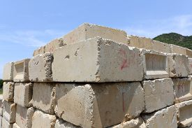 stock photo of cornerstone  - Stack of concrete blocks against a blue sky - JPG