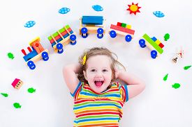 stock photo of daycare  - Child playing with wooden train - JPG