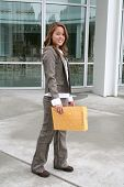 picture of interoffice  - a business woman delivering an envelope of office mail - JPG